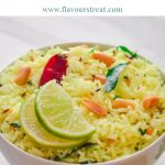 A white bowl of lemon rice topped with 2 half lemon slices, red chilli and a squeezed lime on side with blue text overlay on white background.