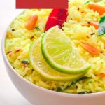 A white bowl of lemon rice topped with 2 half lemon slices and a red chilli with white text overlay on a red background.