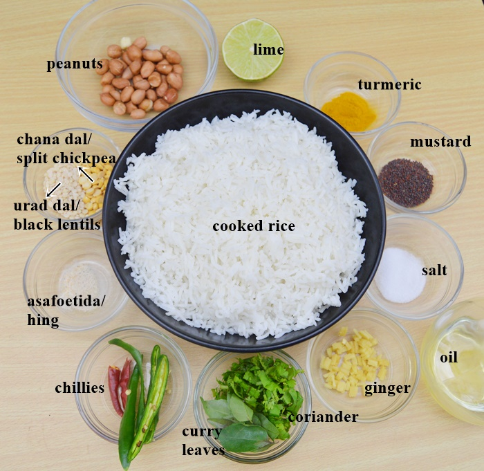 ingredients to make lemon rice placed in bowls on a wooden table.