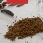 pin image with text overlay on red background showing spice blend on a marble along with whole spices placed next to it.