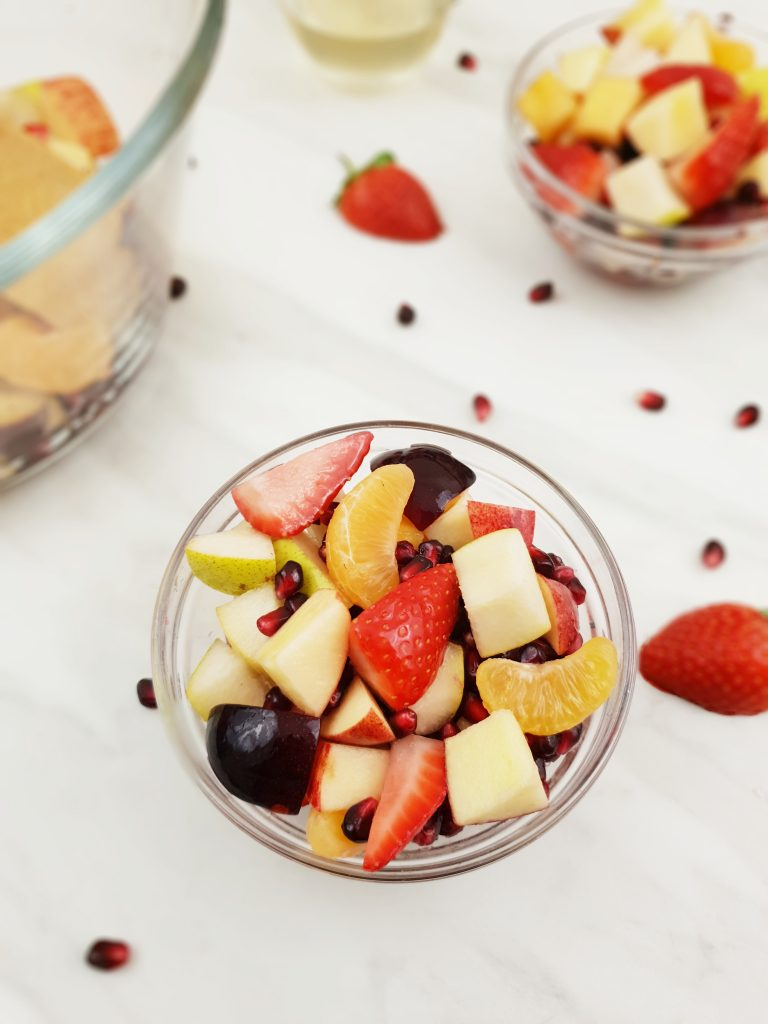 fruit salad with dressing in a bowl.