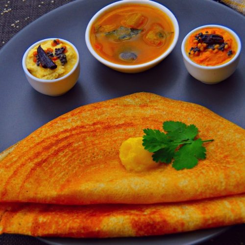 savoury crepes with butter and side dishes on black plate