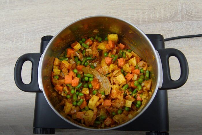 cooking vegetables, spices to make vegetable masala rice