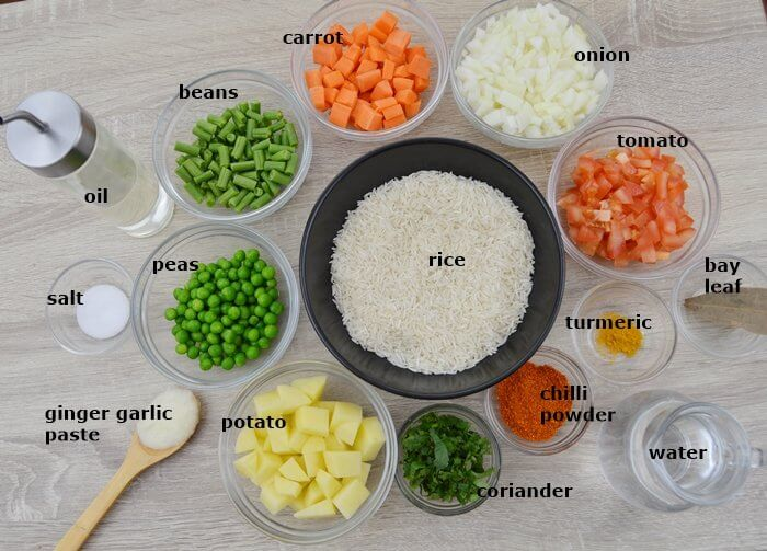 vegatables, rice and dry spices placed on a table.