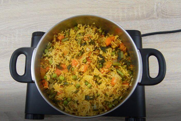 piping hot masala rice in a pot.