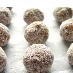 pin image of no bake date energy balls placed on a baking sheet with green text overlay on top.