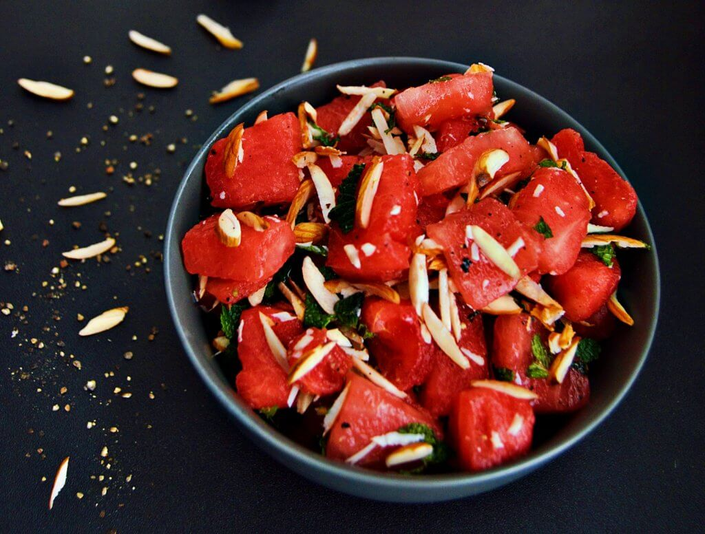 watermelon salad in black bowl.
