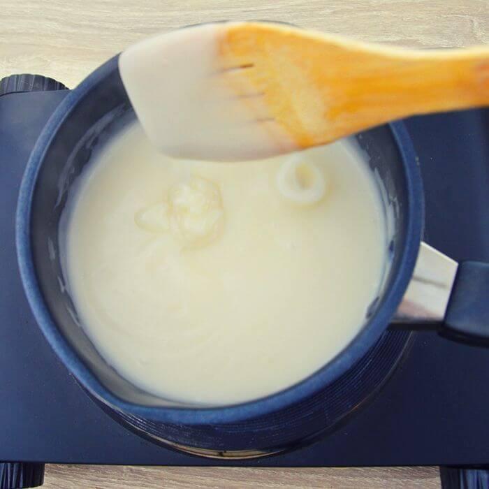 checking consistency of coconut milk custard.