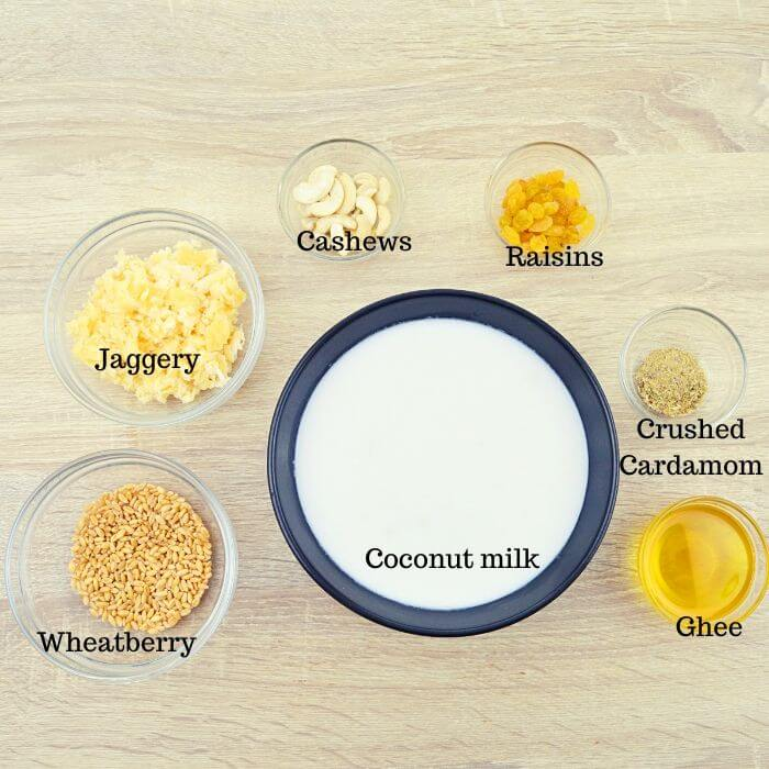 all wheat payasam ingredients in a bowls placed on table.