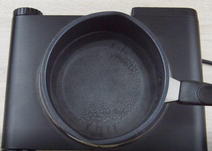 Boiling water in a black tea pan.