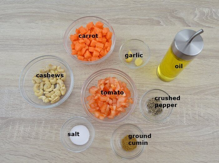 required ingredients in a bowls to make carrot sauce.