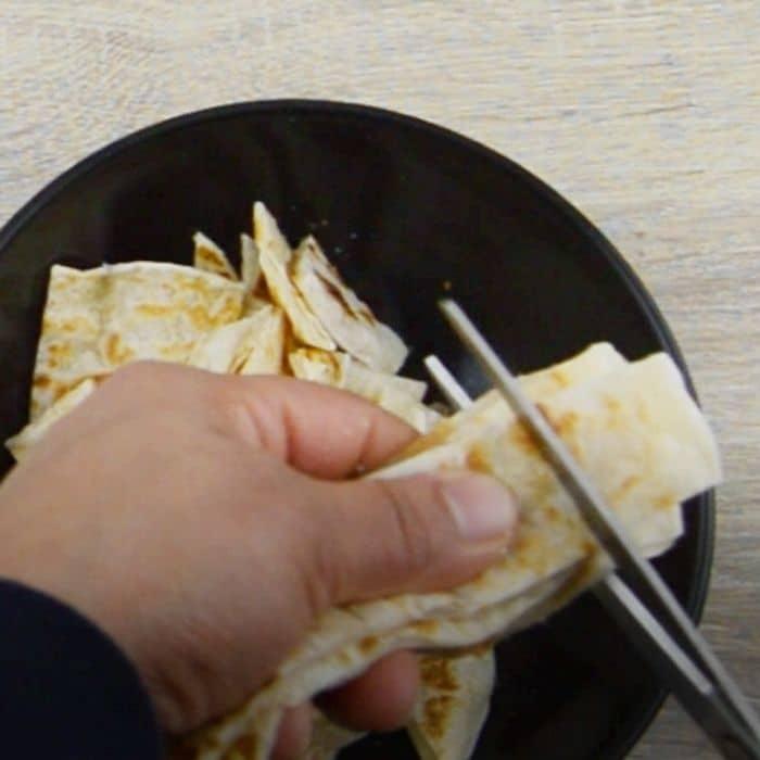 chopping parotta to bite-size pieces to make chilli parotta.