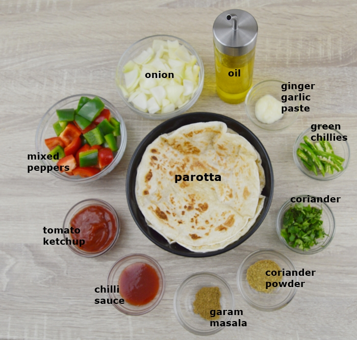Ingredients required to make chilli parotta in individual bowls.