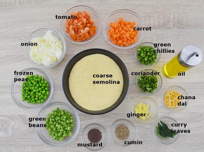 ingredients to make vegetable rava upma placed on table.