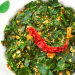 pin image of moringa leaves curry with a dry red chilli in a bowl with text overlay on top and bottom.