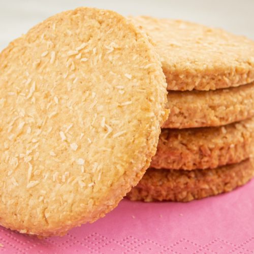 coconut butter cookies placed on pink napkin.