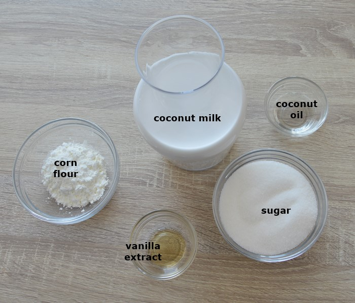 required ingredients to make coconut milk pudding placed on table.