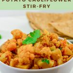 pin image of aloo gobi in white bowl with chapatis in a plate on marble background with text at top and bottom.