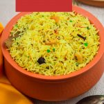 yellow rice in brown pot with orange cloth, fork and a wooden spatula with raw rice and saffron placed on a granite with text overlay on top over red background.