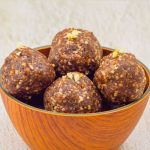 pinterest image showing brown bowl of chocolate energy balls placed on a granite with text overlay on top and bottom.