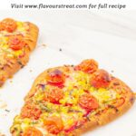 pin image showing vegetable flatbread pizzas on a marble with text overlay on top.