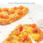 pin image showing vegetable naan bread pizzas on a marble with blue text overlay on top.